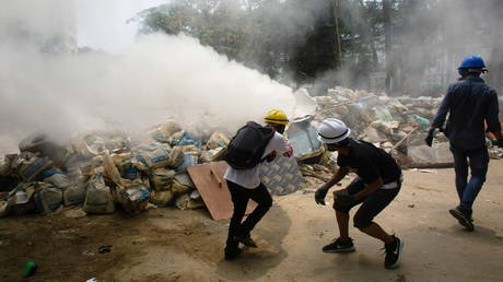 Protesters use fire extinguishers during a protest against the military coup in Yangon, Myanmar March 14, 2021.