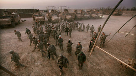 FILE PHOTO: US soldiers from the 3rd Brigade, 1st Cavalry Division depart a mission brief on their way to perform perimeter security at Camp Adder, now known as Imam Ali Base, on December 16, 2011 near Nasiriyah, Iraq