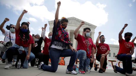 FILE PHOTO: People take a knee in support of the Black Lives Matter movement outside the U.S. Supreme Court in Washington, U.S., June 18, 2020