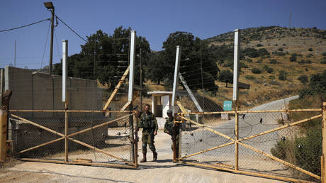 FILE PHOTO: Israeli soldiers open the gate an Israeli military base