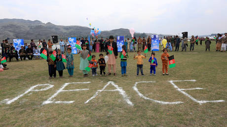 Too soon: Afghan children in Jalalabad, celebrate the US-Taliban peace agreement, February 28, 2020 file photo.
