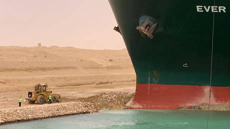 FILE PHOTO. A container ship which was hit by strong wind and ran aground is pictured in Suez Canal, Egypt March 24, 2021. © AFP / SUEZ CANAL
