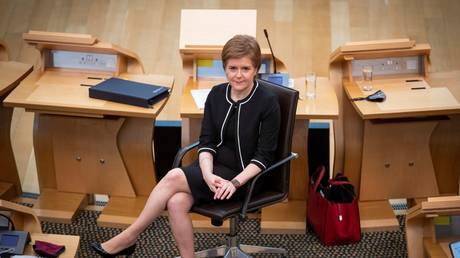 Scotland's First Minister Nicola Sturgeon sits at the main chamber on the Scottish Parliament