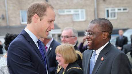 FILE PHOTO. Britain's Prince William, the Duke of Cambridge shakes hands with Chief Executive of homeless charity Centrepoint Seyi Obakin (R) as he leaves following his visit to St Basil's youth homeless charity project in Birmingham on November 29, 2013. © AFP / Chris Jackson