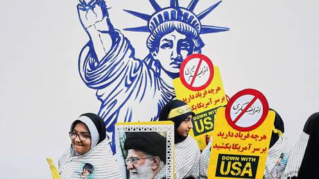 FILE PHOTO. An Iranian protester holds a picture of Iranian Supreme Leader Ayatollah Ali Khamenei. © WANA / Nazanin Tabatabaee