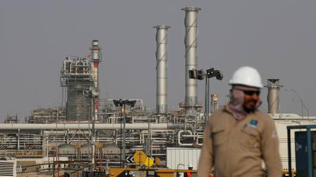 FILE PHOTO: An employee looks on at an oil facility in Abqaiq, Saudi Arabia.