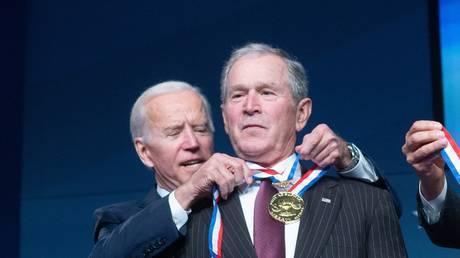 Former Vice President Joe Biden presents George W. Bush the 2018 Liberty Medal at The National Constitution Center on November 11, 2018 in Philadelphia, Pennsylvania