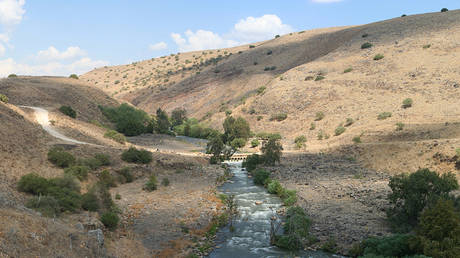 """The Jordan River and """"Kfar-Hanasi"""" bridge."""