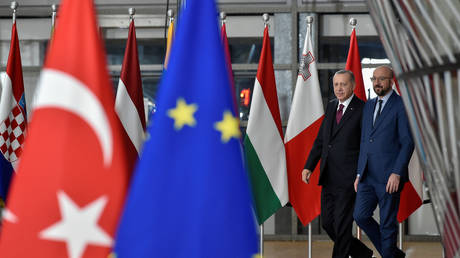 EU Council President Charles Michel (R) arrives with Turkish President Tayyip Erdogan before a meeting with European Commission President Ursula von der Leyen at the EU headquarters in Brussels, Belgium March 9, 2020.