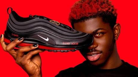 Rapper Lil Nas X posing with custom limited-run 'Satan Shoes'