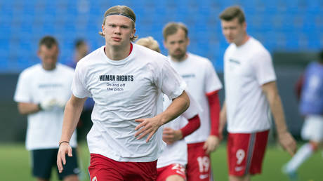 Norway star Erling Haaland wears a t-shirt with a protest message before a recent World Cup qualifier. © AFP