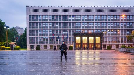 A police officer stands in front of the Slovenian National Assembly building in Ljubljana on May 15, 2020