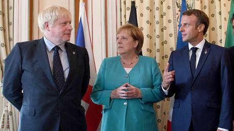 FILE PHOTO: Britain's Prime Minister Boris Johnson, French President Emmanuel Macron and German Chancellor Angela Merkel