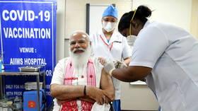 Indian PM Modi receives domestic coronavirus vaccine as country expands inoculation program to seniors