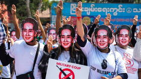 Myanmar's ousted leader Suu Kyi is seen for first time in weeks & now faces new charges, as anti-coup protests rage on
