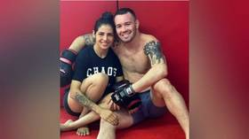 Brazilian MMA stunner Viana takes heat after posing with UFC star Covington – who branded fans from her homeland 'filthy animals'