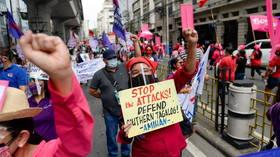 Philippines human rights watchdog launches probe as nine killed in anti-communist raids Duterte govt says were 'legal'