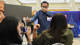First row may get wet: Thai PM sprays journalists with hand sanitizer after being irked by cabinet reshuffle question