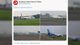 Boeing 737 cargo plane skids off runway into field during hard landing in Indonesia (VIDEO)