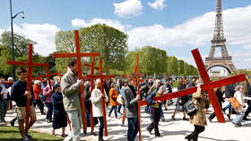 France urges people not to gather over Easter as Covid surges, but religious services will be held