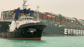 Traffic through Suez Canal fully suspended, as tugs try to free stuck container ship