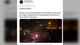 Protest outside Oklahoma jail after police shoot & kill inmate who took corrections officer hostage over poor conditions (VIDEO)
