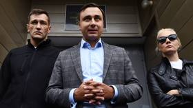 Close Navalny ally blames Kremlin for father's arrest on abuse of power charges, claims it's motivated by his political activities