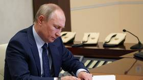 Putin calls on nations across world to create new 'legally binding' global cyberspace treaty, as hack attack row with US escalates