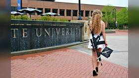 Instagram CENSORS iconic graduation photo of 'Kent State Gun Girl' but allows 'direct threats' in her DMs