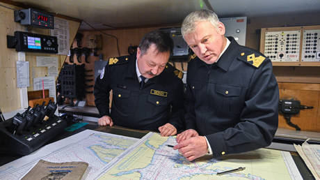 FILE PHOTO. Sedov sail training ship's captain Victor Nikolin, left, and captain-mentor Mikhail Novikov plot a route to Olenya Guba on board of the ship in the waters of the Barents Sea, Russia. © Sputnik