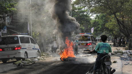A fire burns on the street during a protest against the military coup, in Mandalay, Myanmar on April 1, 2021.