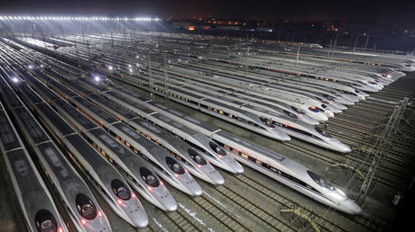 FILE PHOTO: China Railway High-speed Harmony bullet trains are seen at a high-speed train maintenance base, as the Spring Festival travel rush begins, in Wuhan, Hubei province, China February 1, 2018