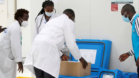 FILE PHOTO. Biomedical engineers pack a consignment of AstraZeneca vaccines in Kenya.