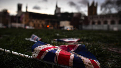 FILE PHOTO: Union Jack flags are left on the ground following last nights Brexit celebrations on February 1, 2020 in London, England