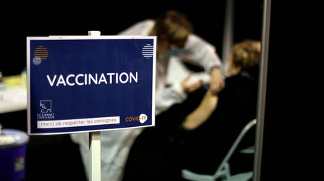 FILE PHOTO: A senior citizen receives the Moderna coronavirus disease (COVID-19) vaccine at a vaccination center in Le Cannet, France, January 19, 2021