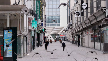 FILE PHOTO. eople walk along an almost empty shopping street, while Belgian government imposed a coronavirus lockdown in an attempt to slow down the coronavirus disease (COVID-19), in Brussels, Belgium March 20, 2020. © Reuters / Yves Herman