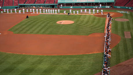 FILE PHOTO: The entire Baltimore Orioles team kneels during a Black Lives Matter demonstration prior to first pitch against the Boston Red Sox on Opening Day at Fenway Park on July 24, 2020 in Boston, Massachusetts