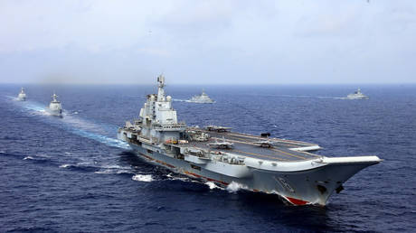 FILE PHOTO: China's aircraft carrier Liaoning takes part in a military drill of Chinese People's Liberation Army (PLA) Navy in the western Pacific Ocean, April 18, 2018