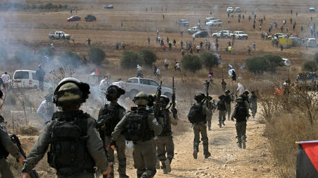 Israeli border guards rush to the scene of clashes with Palestinian protesters, north of Ramallah in the occupied West Bank, on October 17, 2019