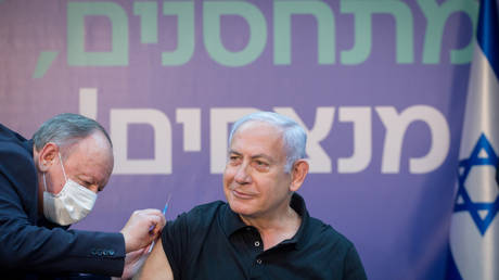 Israeli Prime Minister Minister Benjamin Netanyahu receives the second dose of the Covid-19  vaccine, January 9, 2021.