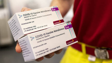 A health worker holds boxes with AstraZeneca's vaccines against the coronavirus SARS-CoV-2 on April 2, 2021 in Vienna, Austria.