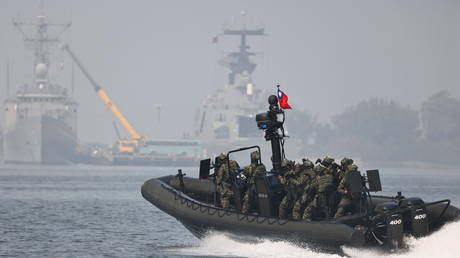 FILE PHOTO: Taiwan Navy special forces conduct a drill ahead of the Lunar New Year in Kaohsiung, Taiwan, January 27, 2021.