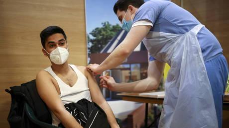 Man receives dose of AstraZeneca Covid-19 vaccine, London, Britain, March 28, 2021