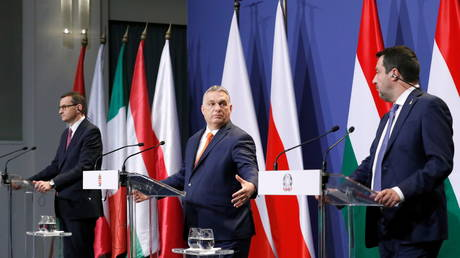 Hungary's Prime Minister Viktor Orban, Poland's Prime Minister Mateusz Morawiecki and Italy's League party leader Matteo Salvini give a statement after their meeting in Budapest, Hungary, April 1, 2021.