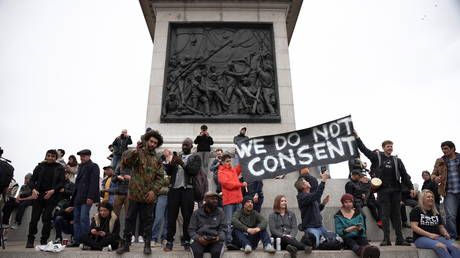 People participate in a protest against the lockdown, amid the spread of the coronavirus disease (COVID-19), in London, Britain March 20, 2021.