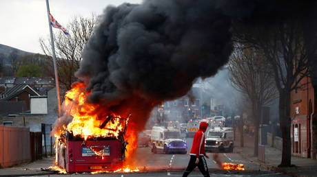 The bus burning on the Shankill Road as protests continue in Belfast, Northern Ireland on April 7, 2021. © REUTERS/Jason Cairnduff