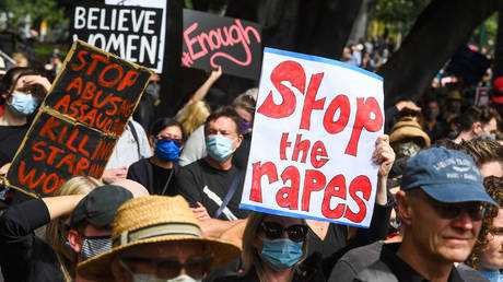 FILE PHOTO. People attend a protest against sexual violence and gender inequality in Melbourne on March 15, 2021.