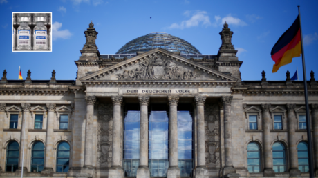 """A German flag flutters in front of the Reichstag building in Berlin, Germany, September 6, 2020. Letters read """"To the German people"""". Picture taken September 6, 2020. © Reuters / Joachim Herrmann; (inset) Sputnik V Coronavirus COVID-19 Vaccine © Reuters / DADO RUVIC"""