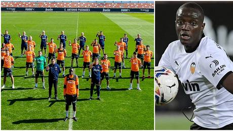 Valencia players show support for teammate Mouctar Diakhaby after claims he was racially abused. © AFP