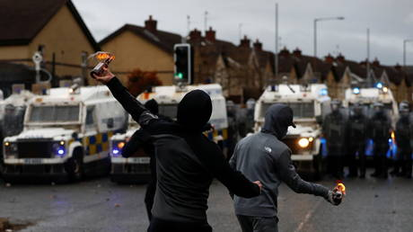 Rioters throw burning bottles at the police on the Springfield Road as protests continue in Belfast, Northern Ireland (FILE PHOTO) © REUTERS/Jason Cairnduff